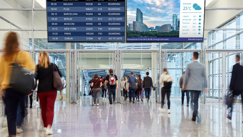 Digital Signage Displays in the airport show digital signage content.