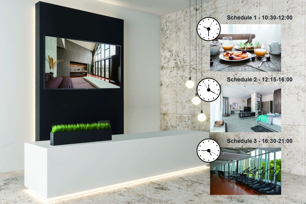 A digital signage display is mounted on the hotel lobby wall and scheduled to broadcast content at different time.