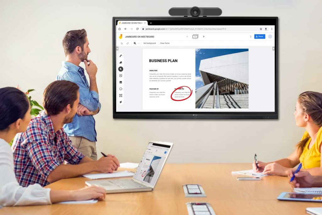 People are doing wireless presentation using AG Neovo Meetboard and video conferencing camera