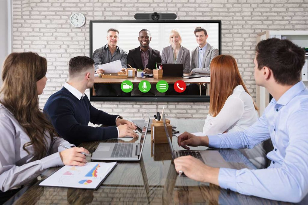 A group of people are using all-in-one video conference camera with Meetboard interactive display